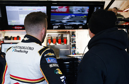 Austin Dillon & RCR team member watch race footage behind the scenes