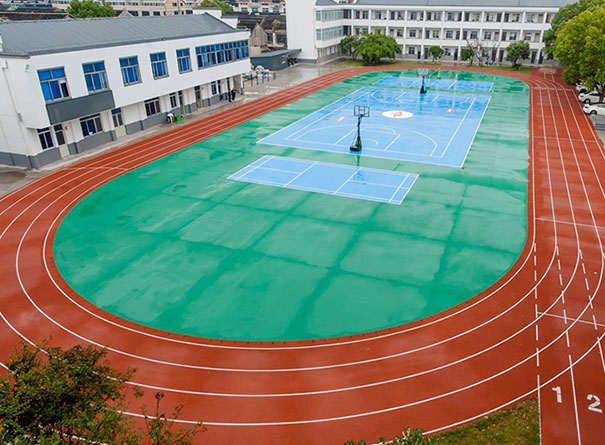 Overhead view of running track, basketball court and badminton court using Dow technologies