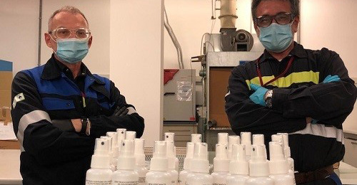 Workers prepare sanitizer for shipping