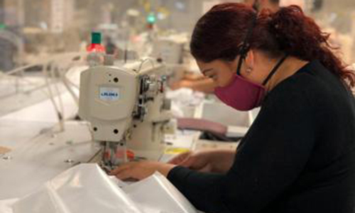 Medical gowns being produced